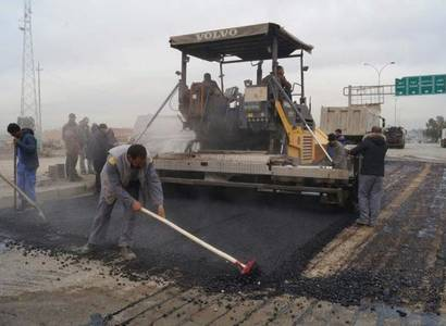 Pavement and fixing the shoulders of Baghdad and Mosul Roads, at Two ways from Baiji Refinery.